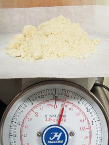 I put a sheet of wax paper on my scale so after the meal is weighed I can easily lift it off and pour into the sifter.