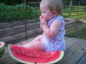 My daughter Addie, enjoying a watermelon that I didn't grow.