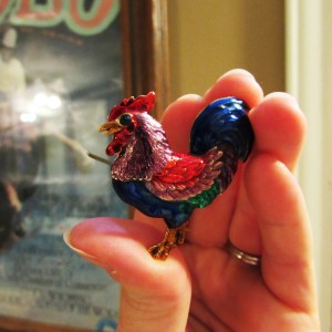 Proof: My favorite brooch.  A chicken, naturally.